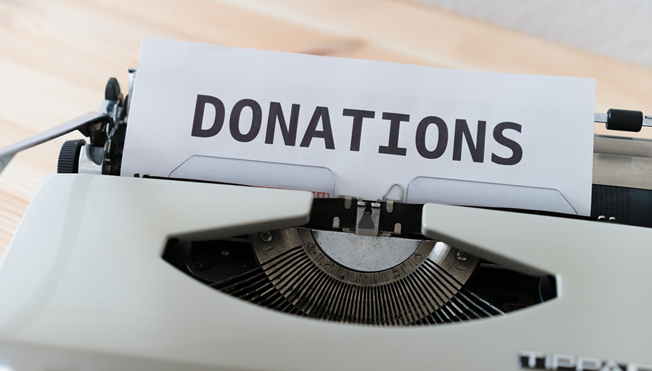 """Image showing a typewriter with the word """"donations""""."""